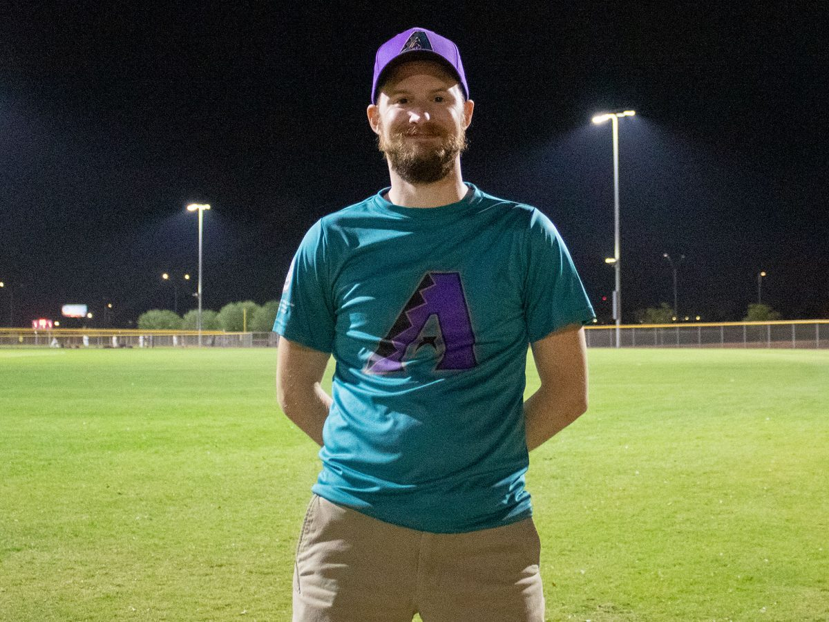 Ron Stauffer standing on a baseball field at night wearing Arizona Diamondbacks gear